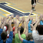 The crowd goes nuts as the Muskie basketball team scores their 10th point against Edgewood.